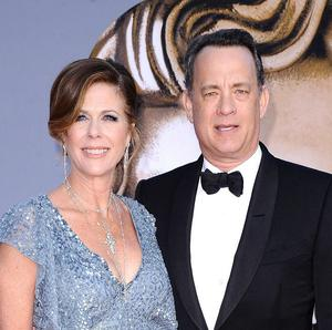 An insurance broker who overcharged Tom Hanks and his wife, Rita Wilson, has been jailed (AP)
