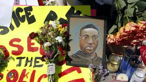 A portrait of George Floyd in a memorial for him near the site of his arrest (AP/Jim Mone)