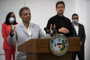 Chicago Mayor Lori Lightfoot, joined by Chicago Public Schools chief Dr Janice K Jackson, left rear, announce a preliminary reopening framework for public schools (E Jason Wambsgans/Chicago Tribune via AP)