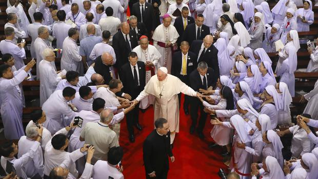 Priests, religious seminarians and Catechists touch the hands of Pope Francis at Saint Peter's Parish on the outskirts of Bangkok, Thailand (Manish Swarup/AP)
