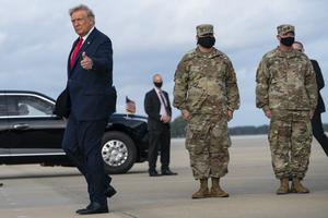 Donald Trump gives a thumbs up after arriving at an event with troops (AP/Evan Vucci)