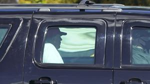 President Donald Trump seen leaving his golf course in Wet Palm Beach, Florida, on Sunday, while politicians on both sides urged him to act over the Covid-19 relief bill (Patrick Semansky/AP)