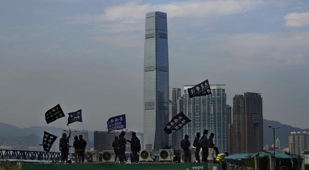 Protesters wave flags that read Hong Kong Independence during a rally (Vincent Yu/AP)