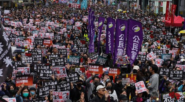 Hong Kong people participate in their annual New Year's Day pro-democracy march (Vincent Yu/AP)