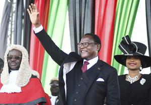 Malawi's newly elected President Lazarus Chakwera greets supporters after being sworn in in Lilongwe (Thoko Chikondi/AP)