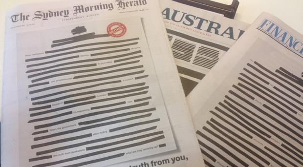 Australian newspapers with 'censored' front pages (Padraig Collins/PA)