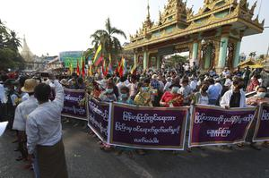 Supporters of the Myanmar military and the military-backed Union Solidarity and Development Party protest election results in Yangon on Saturday (Thein Zaw/AP)