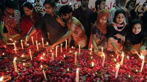 Pakistani children and members of a civil society light candles during a vigil for the victims of a suicide bombing attack on churches (AP)