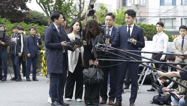 Cho Hyun-min bows as she arrives at a police station in Seoul (Ahn Young-joon/AP)