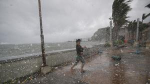 A man battles strong winds and rain from Typhoon Hagupit in Legazpi, Albay province (AP)