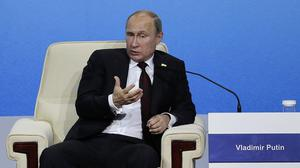 Vladimir Putin's administration has signed a contract for building two reactors at Iran's first Russian-built nuclear plant. (AP)