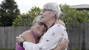 Christine Archer, right, is reunited with her sister Gail Baker (AuBC via AP)