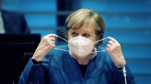 Angela Merkel believes the German health system could be overwhelmed without action (Kay Nietfeld/dpa via AP, pool)