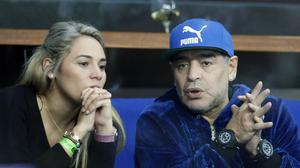 Diego Maradona with girlfriend Rocio Oliva. (AP/Darko Bandic)
