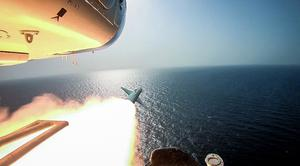 The Revolutionary Guard's helicopter fires a missile (Sepahnews via AP)