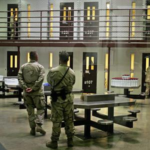 Guantanamo guards keep watch over a cell block with detainees in Camp 6 maximum-security facility, at Guantanamo Bay (AP/Brennan Linsley)