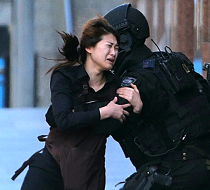 A hostage in the Lindt Cafe siege runs into a police officer's arms