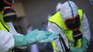 Spanish Royal Guard soldiers during disinfection work at a hospital to prevent the spread of coronavirus (Bernat Armangue/AP)