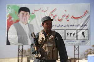Afghan police stand guard at a checkpoint (Rahmat Gul/AP)