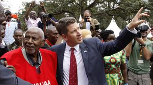 Gitu wa Kahengeri (left), Secretary General of the Mau Mau War Veterans Association, and British High Commissioner to Kenya Christian Turner attend the unveiling of the Mau Mau veteran memorial in Nairobi (AP)