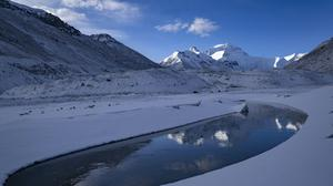 The team will use the period of quiet on Mount Everest to measure its height (Purbu Zhaxi/Xinhua via AP)