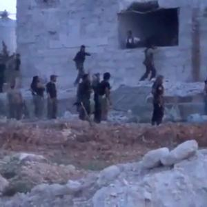 Rebel fighters were filmed at an army base in Nairab, north-western Syria (AP)