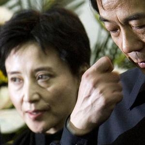 Gu Kailai, left, wife of then Chinese commerce minister Bo Xilai, right, was convicted of the murder of UK businessman Neil Heywood (AP)