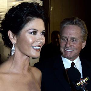 "Catherine Zeta-Jones and Michael Douglas are spending time apart to ""evaluate and work on their marriage"" (AP)"
