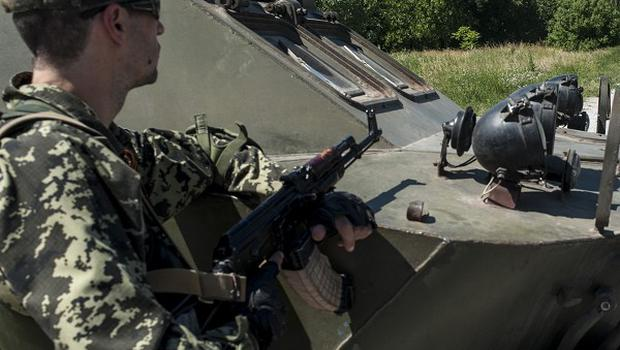 Pro-Russian fighters guard a checkpoint in Donetsk, eastern Ukraine (AP)