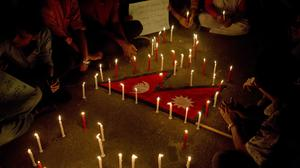 People honouring the victims of Monday's plane crash in Kathmandu, after gathering in Dhaka, Bangladesh (AP Photo/A.M. Ahad)