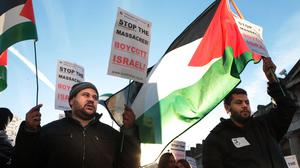 Palestinian demonstrators protest against Israeli bombing