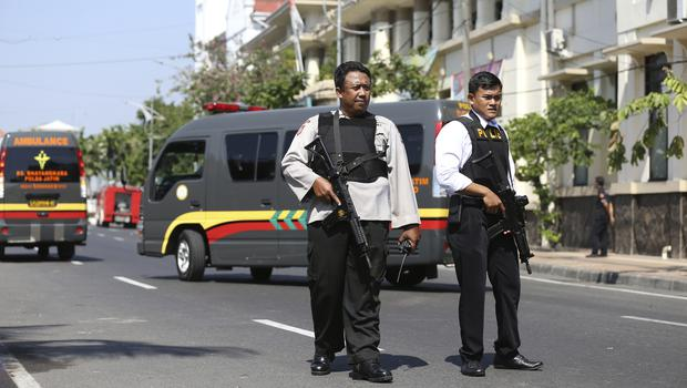 Officers stand guard following an attack at the local police headquarters in Surabaya, Indonesia (AP Photo/Achmad Ibrahim)