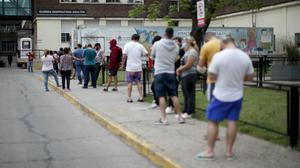 People line up to get Covid-19 tests at a hospital in Buenos Aires (Natacha Pisarenko/AP)