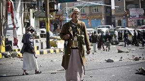 Houthi Shiites gather while guarding a street leading to the presidential palace in Sanaa, Yemen. (AP)