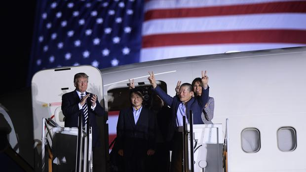Mr Trump and the three released men at Andrews Air Force Base in Maryland (Susan Walsh/AP)