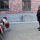 Speaker Nancy Pelosi, centre, and speakers of Poland's parliament lay wreaths at the executions death wall (US Consulate General/AP)
