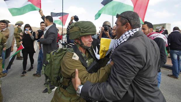 Israeli soldiers confront Palestinian protesters near the West Bank town of Jericho. (AP)