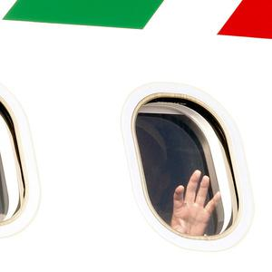 A papal wave from the departing aircraft (AP)