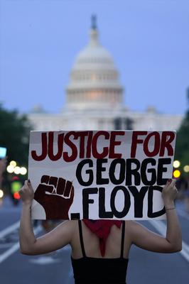 Demonstrators walk along Pennsylvania Avenue as they protest the death of George Floyd (Evan Vucci/AP)