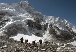 Porters transport supplies around Everest base camp (David Cheskin/PA)