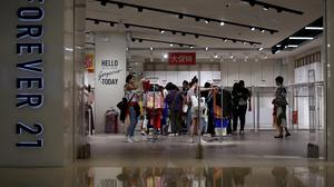 Forever 21 offers clearance discounts at a shopping centre in China (Andy Wong/AP)
