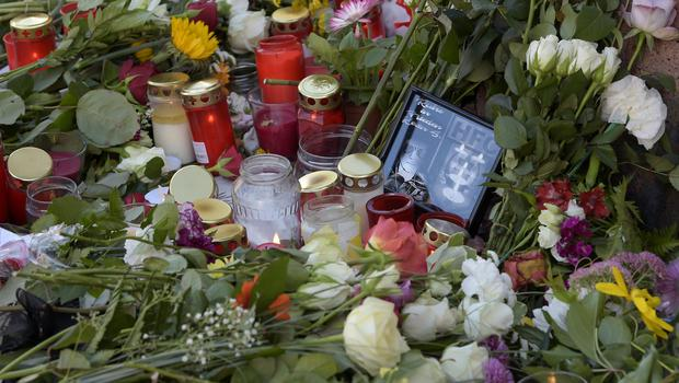 Flowers and candles haev been left at the scene of the attack in Halle (Jens Meyer/AP)