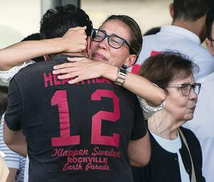 Relatives of passengers involved in the train crash comfort each other as they wait for news of the victims AP/David Ramos