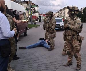The assailant lies on the ground after police officers captured him (Ukrainian Police Press Office via AP)