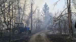Chernobyl zone workers extinguish a forest fire burning near the village of Volodymyrivka, in the exclusion zone around the Chernobyl nuclear power plant, Ukraine, Sunday April 5, 2020. Ukrainian firefighters are laboring to put out two forest blazes in the area around the Chernobyl nuclear power station that was evacuated because of radioactive contamination after the 1986 explosion at the plant. (AP Photo/Yaroslav Yemelianenko)