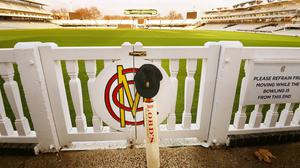 A cricket bat and cap at Lord's Cricket Ground in London, in memory of Australian star Phillip Hughes