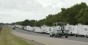 Recreational trailers and boats are parked along LA-46 inside the levee gates in anticipation of Tropical Storm Cristobal in St Bernard Parish Louisiana (Max Becherer/The Times-Picayune/The New Orleans Advocate/AP)