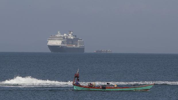 The MS Westerdam, owned by Holland America Line, sails off a port of Sihanoukville (Heng Sinith/AP)