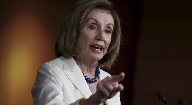 Nancy Pelosi responds forcefully to a question from a reporter (J. Scott Applewhite/AP)