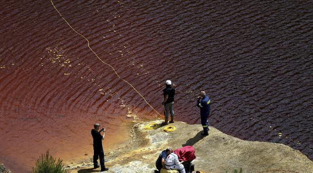 Investigators are searching for bodies with a special camera in a man-made lake near the village of Mitsero outside of the capital Nicosia, Cyprus (Petros Karadjias/AP)